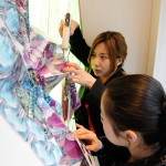 Misha Lee and Cher Jiang put the finishing touches on the Swarovski window display, created by SAIC Fashion, Body and Garment graduate students